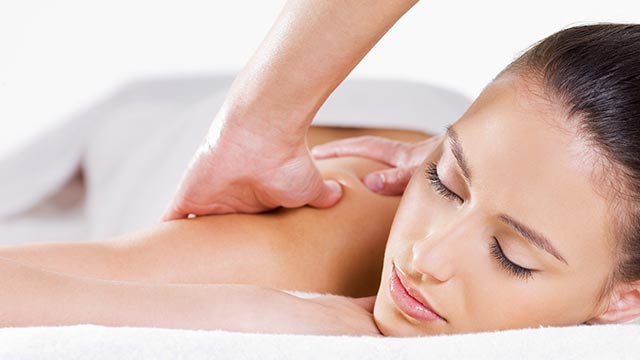 woman receiving healing hands massage therapy